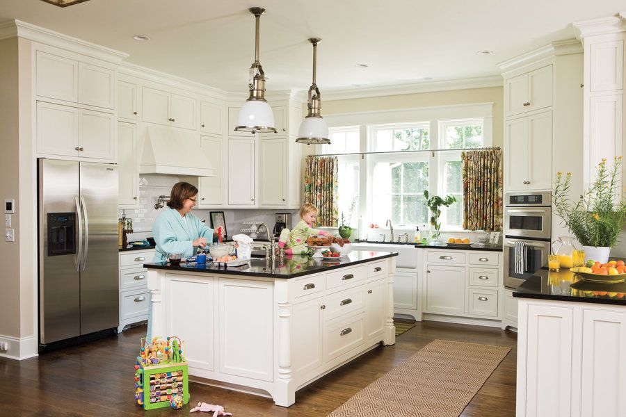 The inset cabinets and bin pulls add to the old-house aesthetic of the room. The homeowners decided to splurge on details in the kitchen and family room because they knew that they would spend most of their time in that area.
