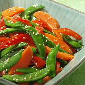The colorful combination of sugar snap peas, red bell pepper and carrot plus an Asian-inspired flavors make this side dish a pleasure to whip up for a weeknight dinner.