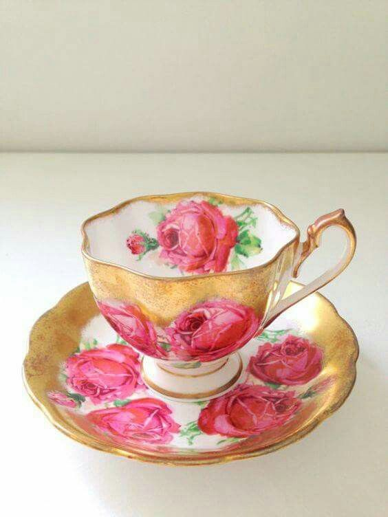 Tea cup/ saucer red roses and gold decoration