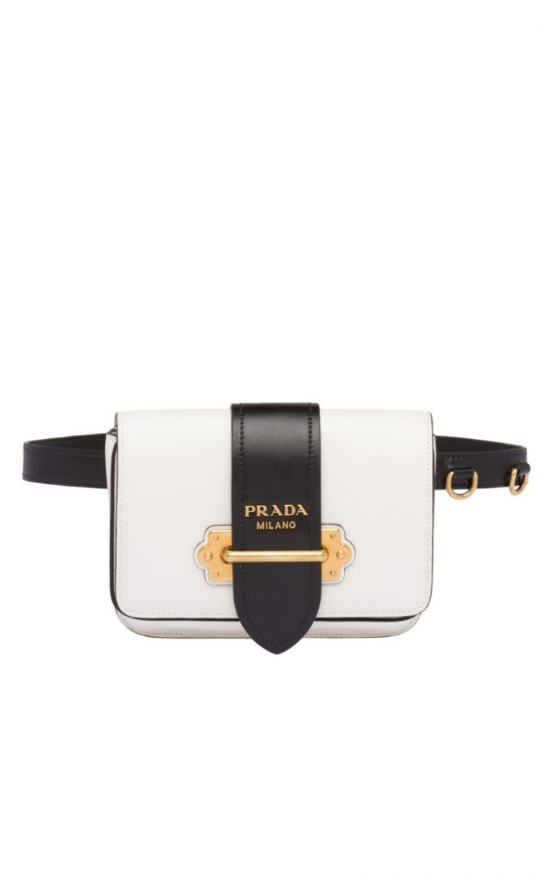 25ccf9bb83a6 This belt bag in white and black toned leather is designed by Prada.  Practical and elegant, the bag features a black leather removable belt as  well as a ...