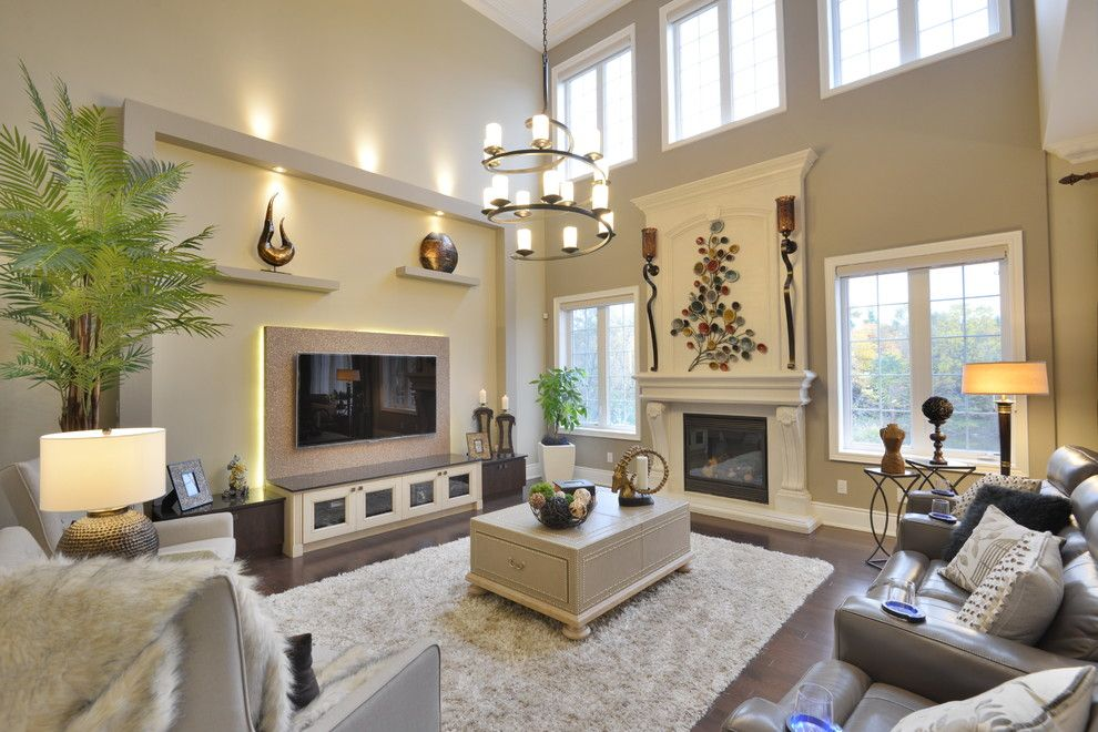Glamorous reclining loveseat with console in family room - Living room with high ceilings decorating ideas ...