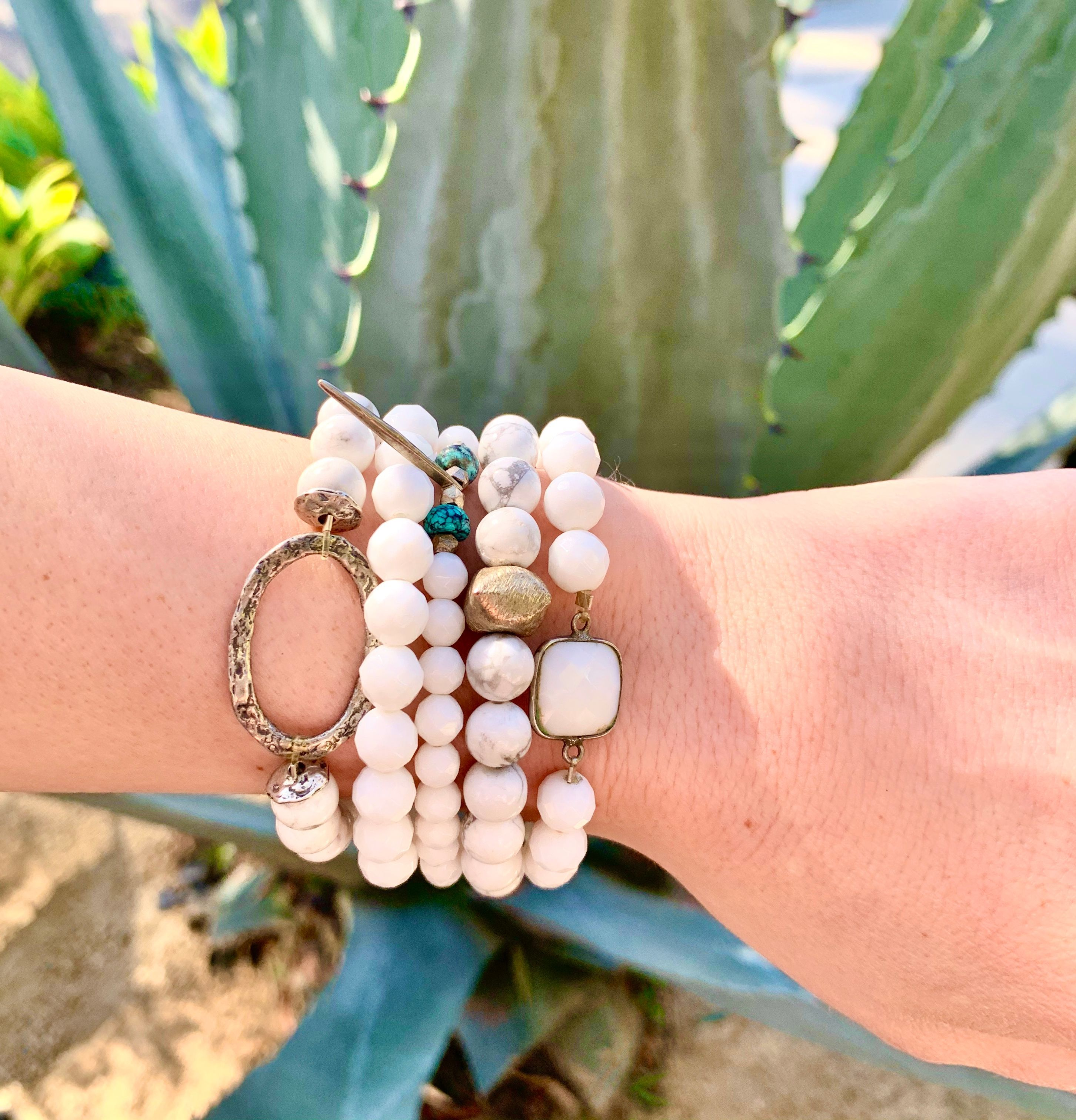 What will help bring you strength, confidence and firm control over one's physical body, emotions and spirituality - White Onyx! Try it on... - - - - - #whiteonyx #bracelets #sterling #stack #orangecounty #costamesa