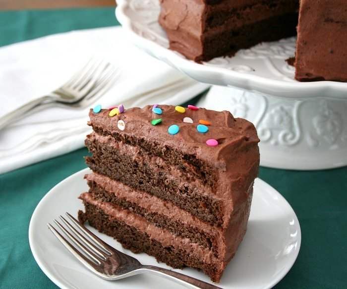 Slice Of Gluten Free Chocolate Cake With Chocolate Sour Cream Frosting And Sprinkles On Top In 2020 Low Carb Chocolate Cake Low Carb Cake Sour Cream Frosting