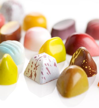 Colored cocoa butter in molded chocolate. Quality colored cocoa butter available at http://www.chocoley.com/list/colorful-cocoa-butter