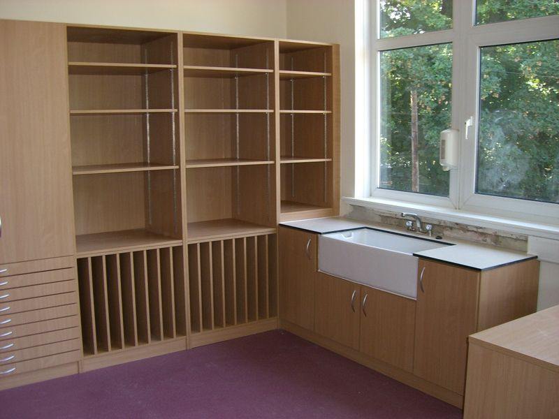 Wall storage with adjustable shelving, Trespa top and a Belfast sink in beech veneer