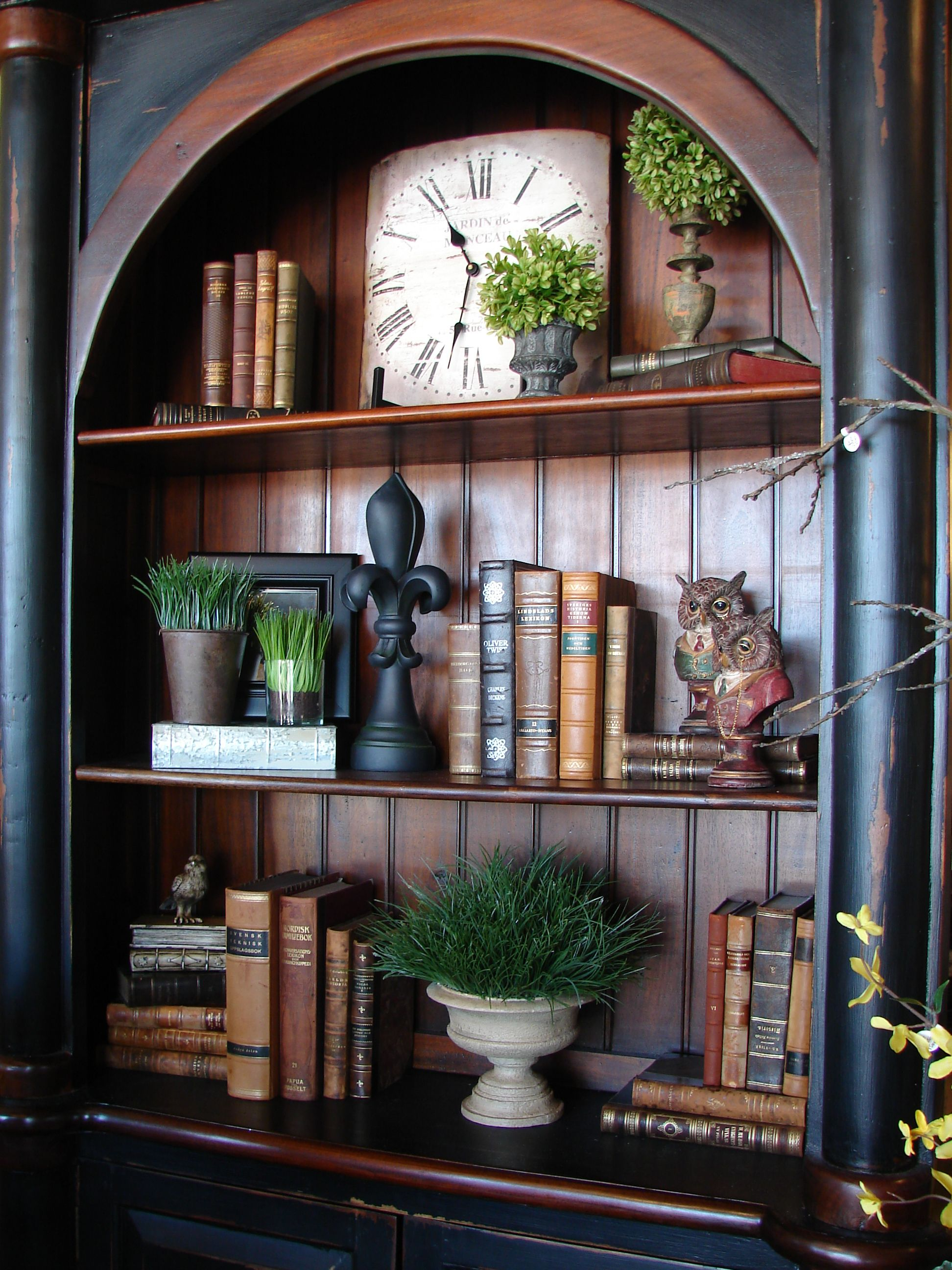 old world leather bound books used in decorating a book shelf at