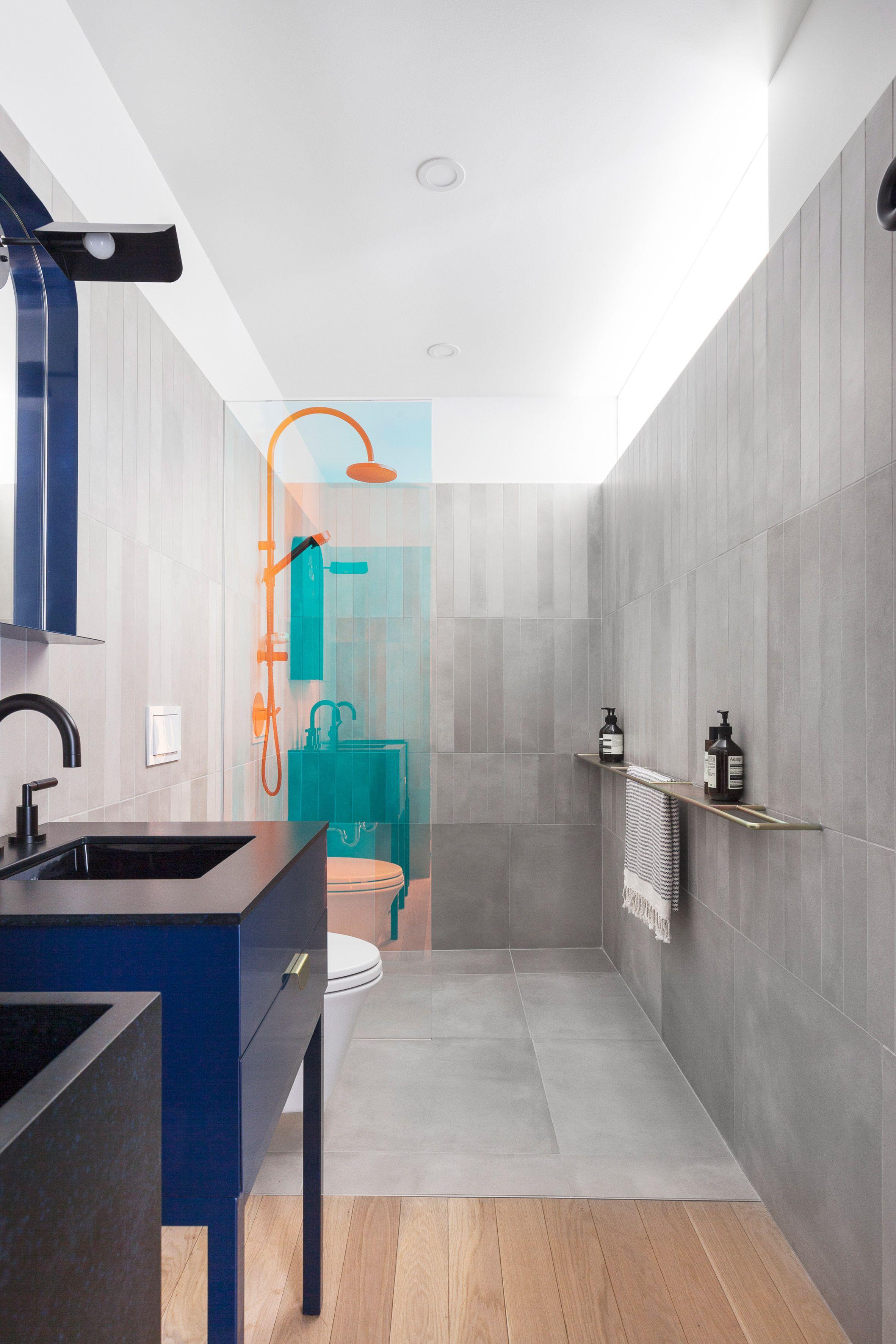 The Bathrooms Feature Vertical Concrete Wall Tiles