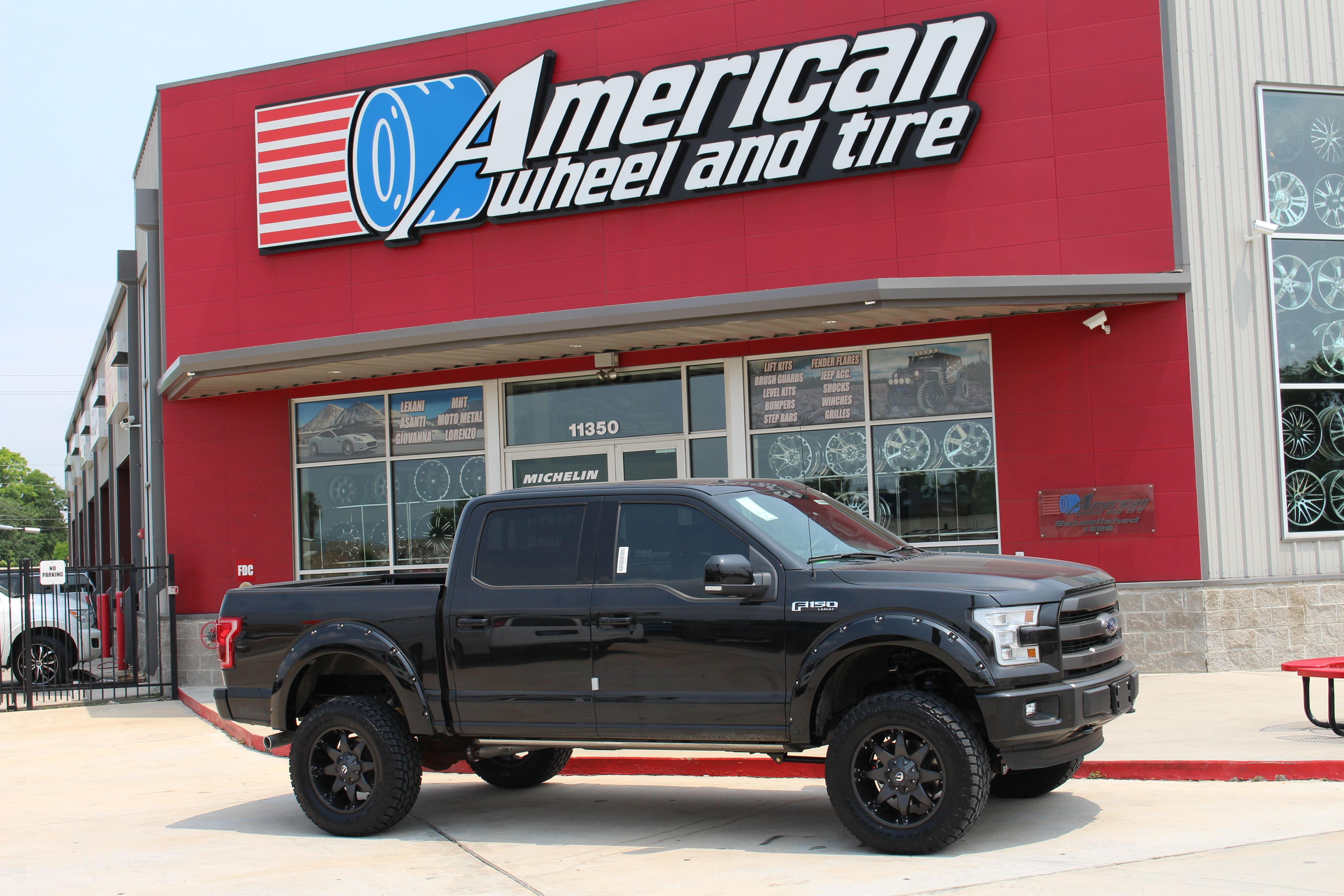 Fuel offroad octane wheels in matte black on a lifted 2015 ford f150 6 pro comp lift kit 20x9 with 35 12 50 20 toyo tires amp research power steps and