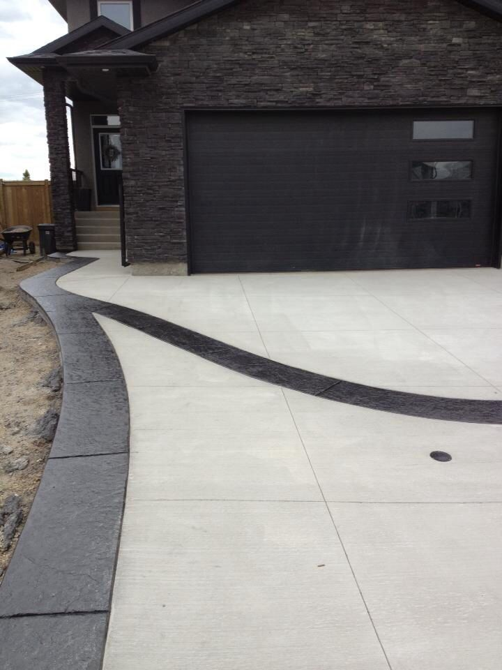 Standard Broom Driveway With Stamped Border Design In