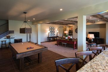 Open Floor Plan Cottage With A Modern Wooden Pool Table Under A Modern  Pendant Light Fixture