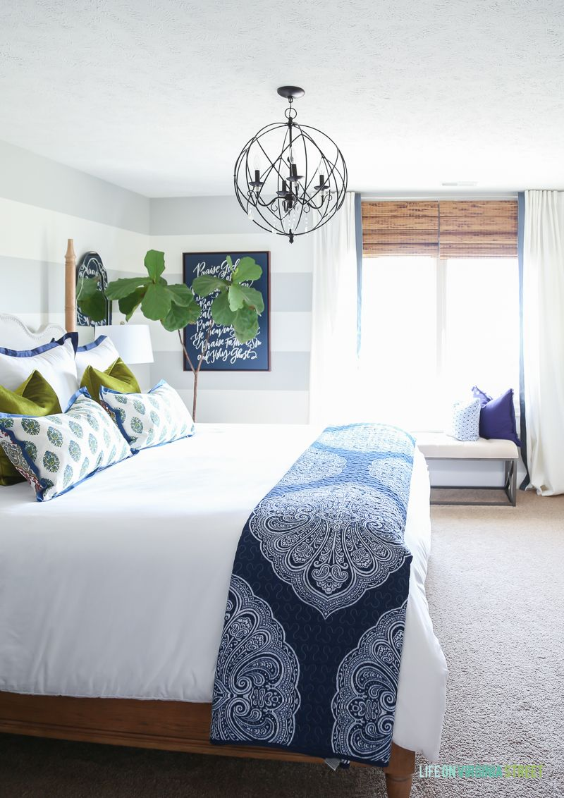 Guest Bedroom With Woven Shades Ribbon Trimmed D White Bedding Navy Blue Paisley Throw Doxology Canvas Fiddle Leaf Fig Tree Chartreuse Velvet