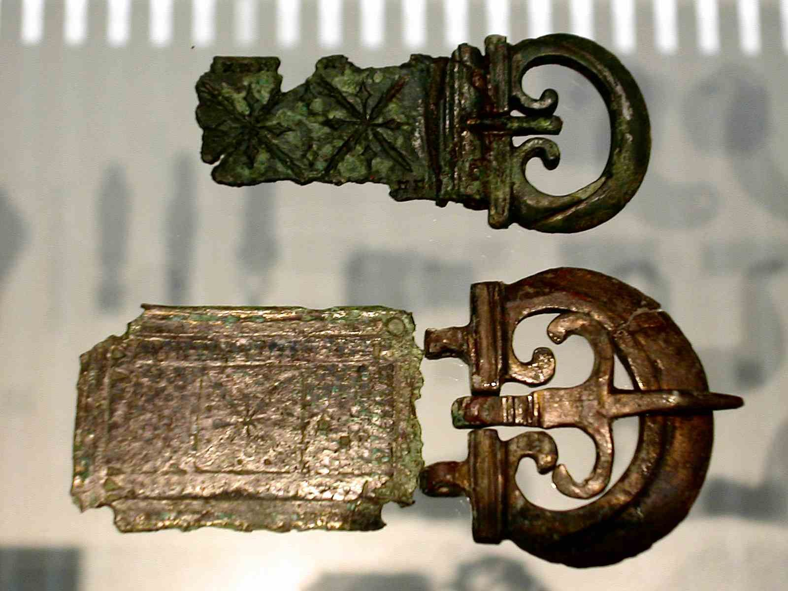 Two Roman belt buckles and plates. The top one is of a early ...