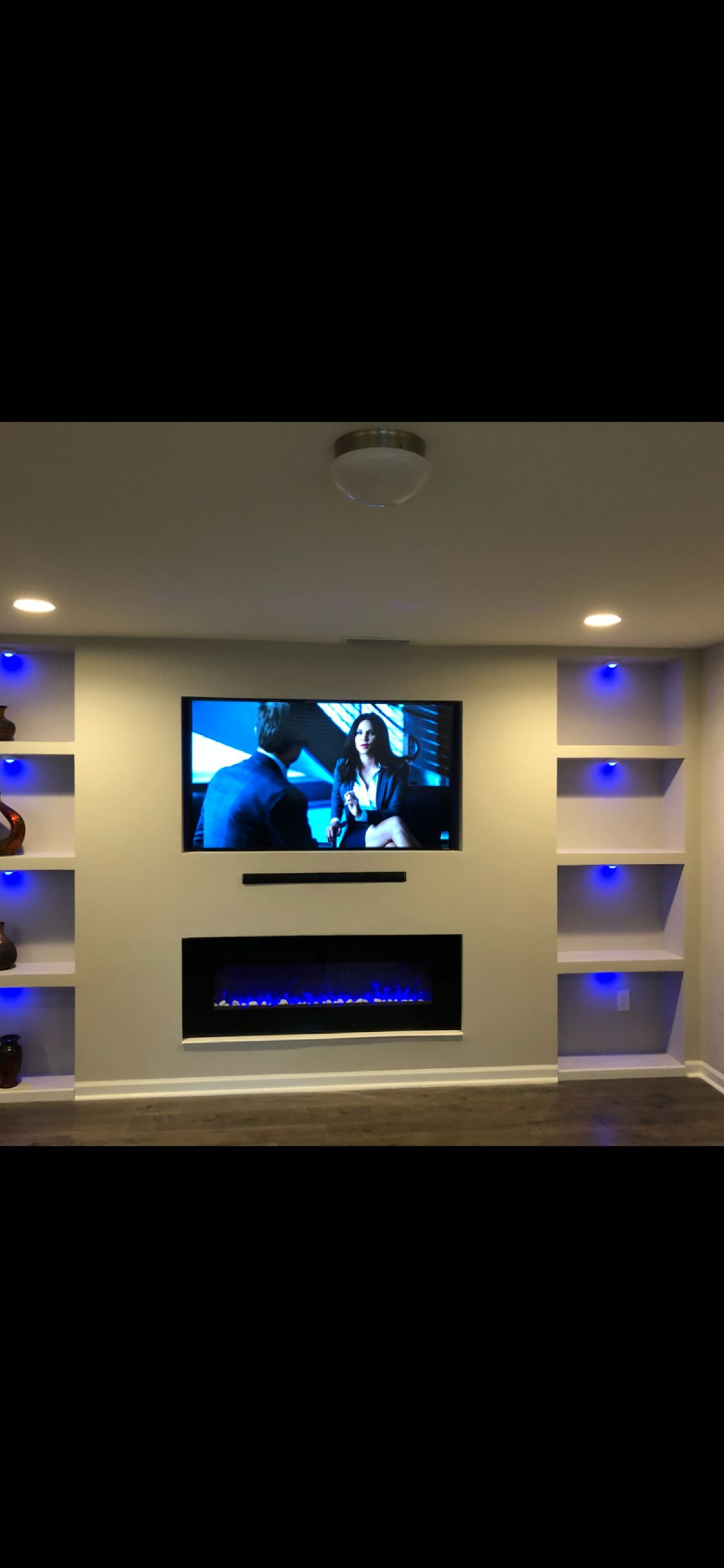 loving this view in my living room my new built in tv and fireplace