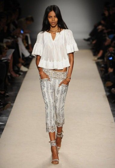 Love the Isabel Marant S/S 2013 collection! The patterns are beautifully embellished with embroidery and beading. And the lovely draping played up by the linear structure of pants and jackets is sublime.