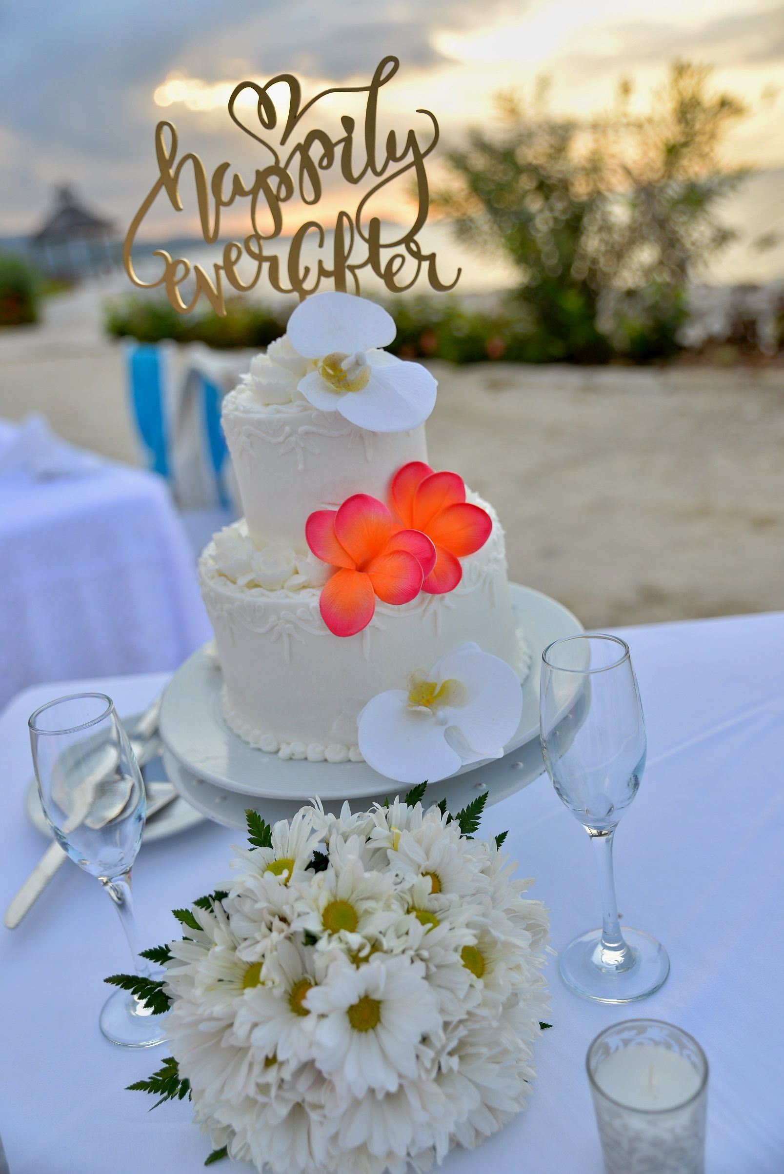 Bright Flowers To Accent A White Cake Creates The Perfect Look Secretswildorchidmontegobay Secretsstjamesmonteg Secrets Wild Orchid Bright Flowers White Cake