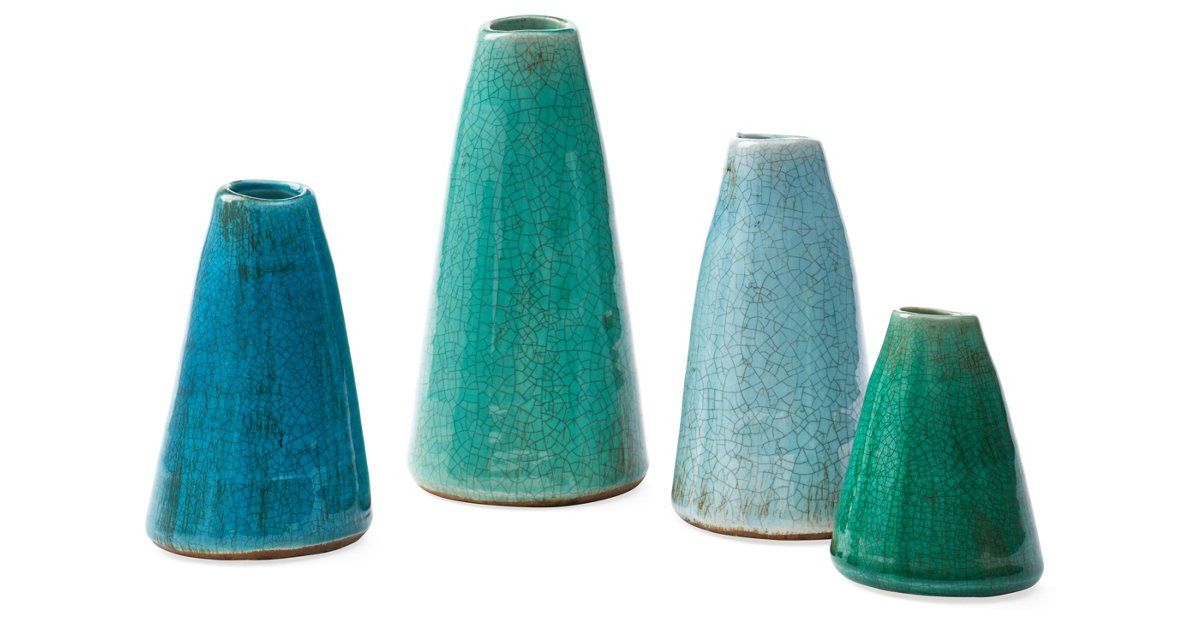 These four terracotta vases feature crackled finishes and cool, tranquil blue hues. In a variety of sizes, they'll add visual interest to a space.