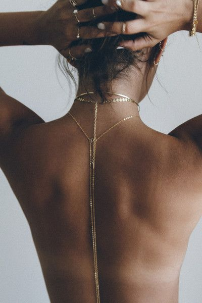 The Ceres Body Chain is a delicate body chain accented with a triangular shape and a small stone, it is made using traditional handmade metalsmithing techniques. This body chain is hand set, soldered,