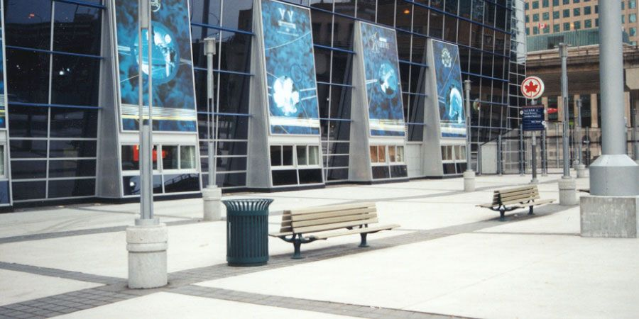 Benches and trash containers surround the Air Canada Centre in Toronto, Ontario.