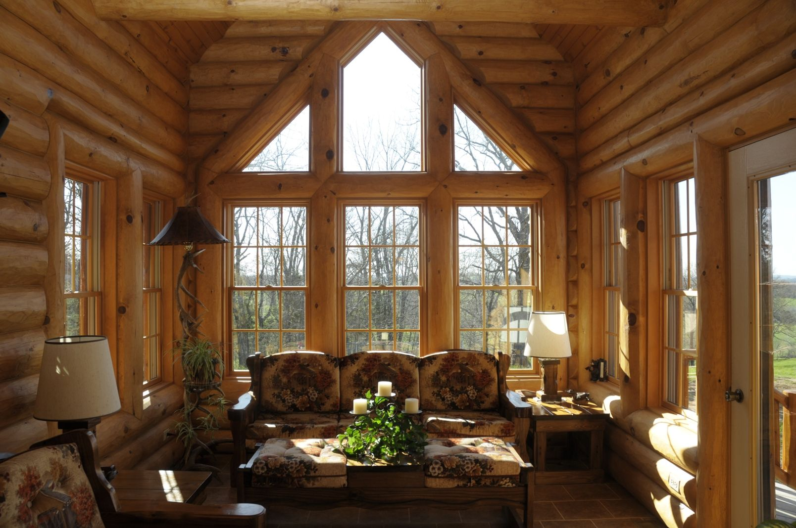 Log home photos sunrooms lofts office expedition for Log home sunrooms