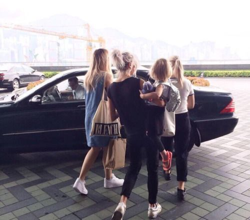 Lottie, Lou, Gemma and Lux leaving their hotel in Hong Kong. (17.03)