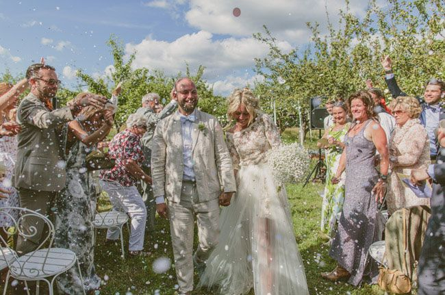her bouquet is all baby's breath - love it! Sweden Apple Orchard Wedding