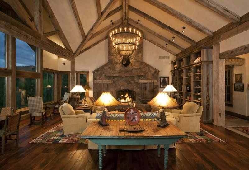 Reclaimed Amish Beams On The Rake Of A High Ceiling Tie In With Other Rustic Features In The