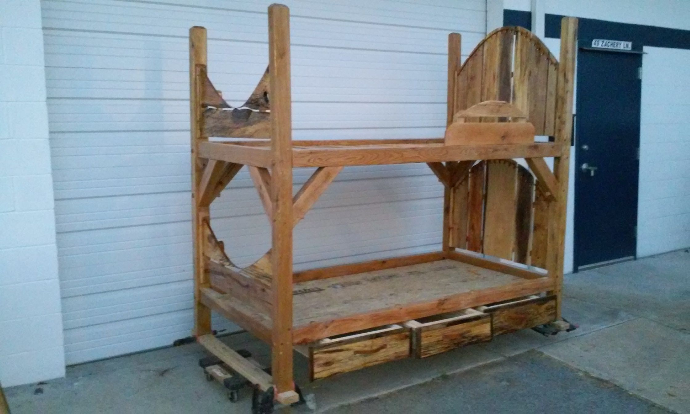 Rustic bunk with drawers. This bed features spalted wood
