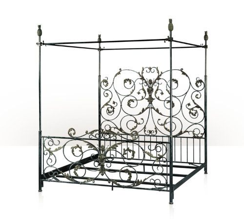 a wrought iron and verdigris brass four poster bed frame