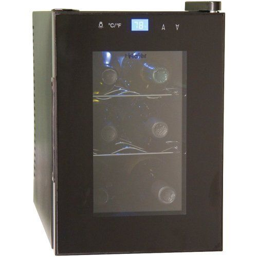 Haier HVTM06ABB 6-Bottle Wine Cellar with Electronic Controls, Black by Petra Industries, Inc. - Consumer Electronics Replen. $89.90. Ideal for countertop use. 6-bottle capacity. Double-Pane Insulated Glass Door with Silver Trim/Black Cabinet. Perfect for red or white wines. Adjustable digital thermostat control with blue led display. 6-Bottle Capacity; Ideal for Countertop Use; Perfect for Red Or White Wines; Double-Pane Insulated Glass Door with Silver Trim/Black ...