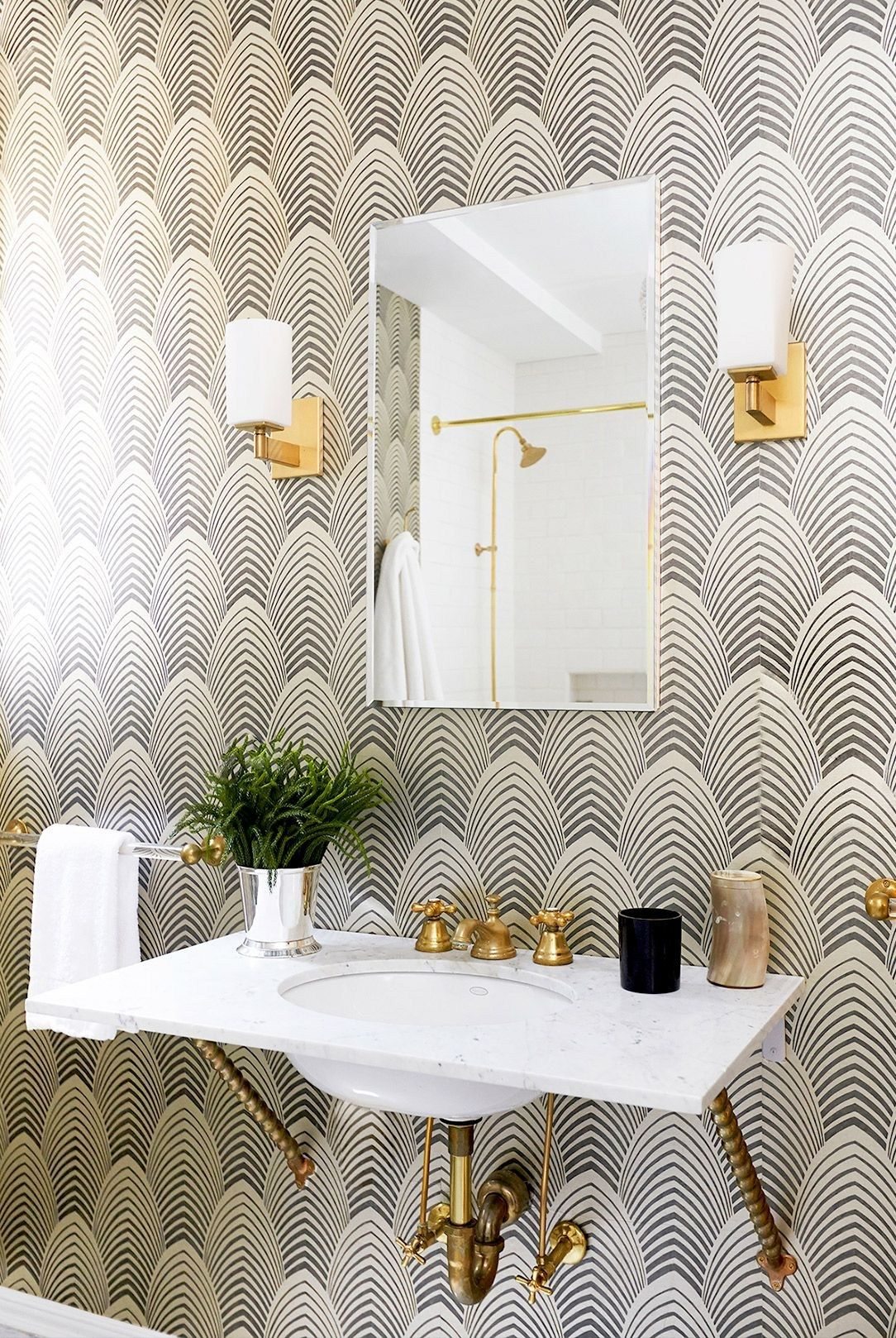 Black and white wallpaper in bathroom with gold sconces   wallpapers ...