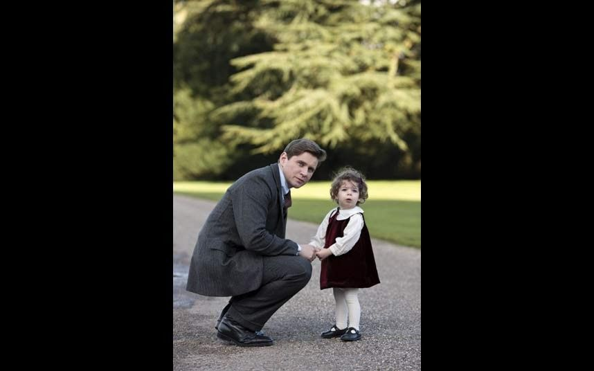 Chauffer Tom Branson (played by Allen Leech) with his daughter, Sybbie.
