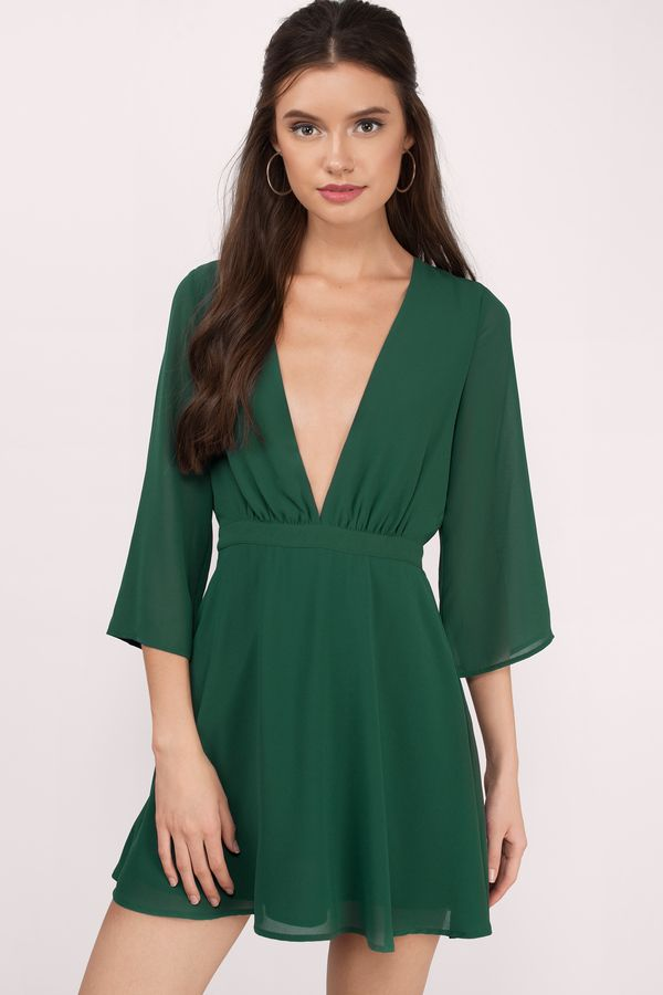 Gorgeous green skater dress featuring a plunging neckline and fitted  waistline with sheer sleeve details. Perfect for an elegant night out this  holiday ... d9e4a8c7b
