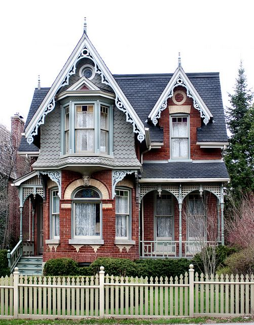 Cabbagetown, Toronto. It has a lot in style with victorians of Toronto; terra cotta, vergeboards, gables with bays, contrasting yellow and orange brick, and a veranda tops it off. This house is on Sumach Street near Necropolis.    The Toronto Project: