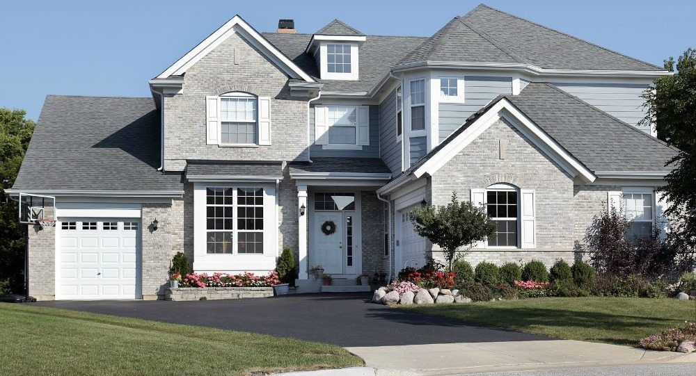 How Much Does An Asphalt Driveway Cost Grey Brick Houses Blue Siding House Painting Cost