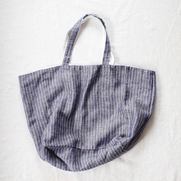 Michael Bag is a 100% linen large tote that comfortably fits on your shoulder. Reversible as it is double thick with...