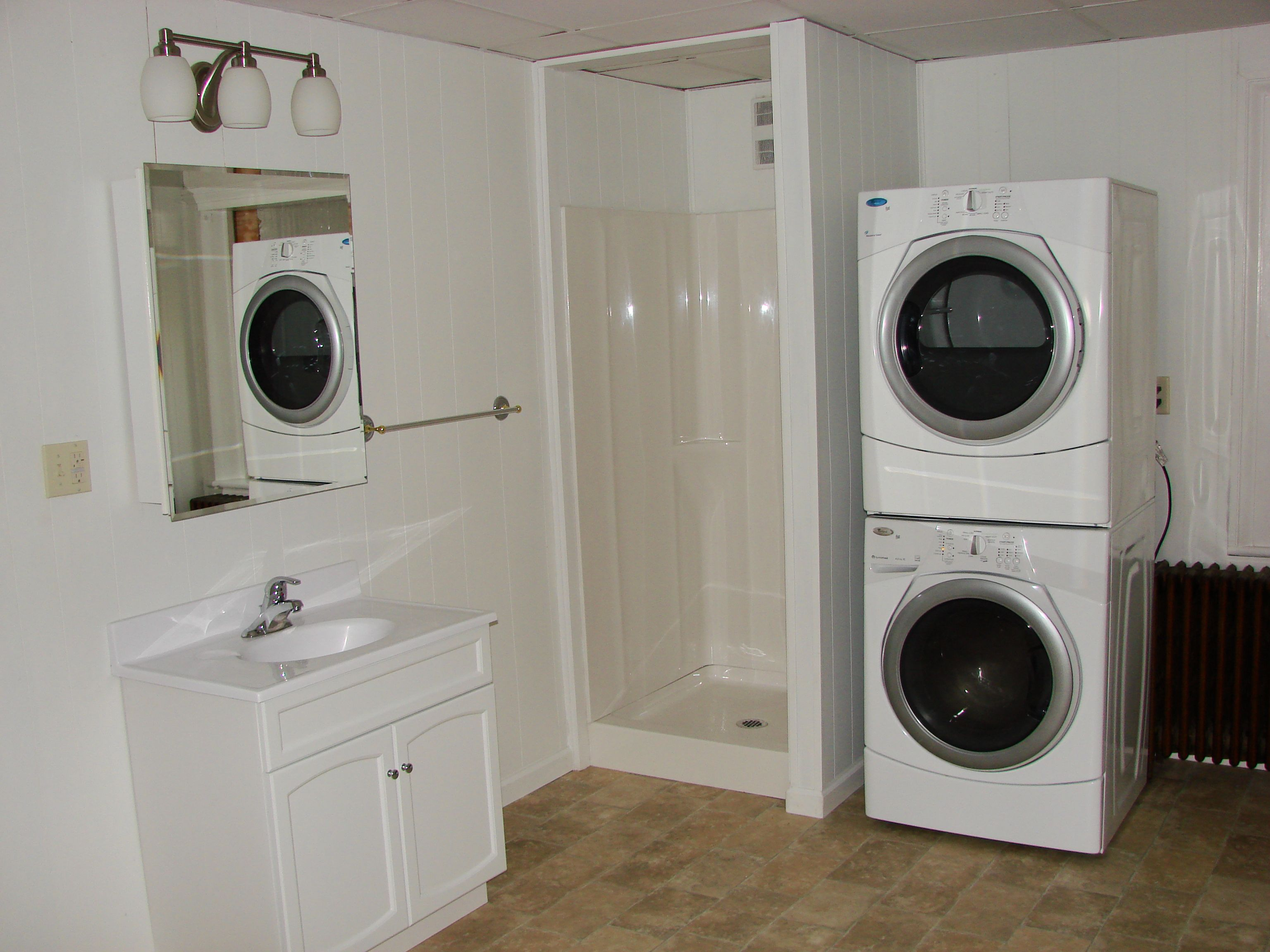 Cool white wash machine and dry machine on the side of for Small bathroom laundry designs