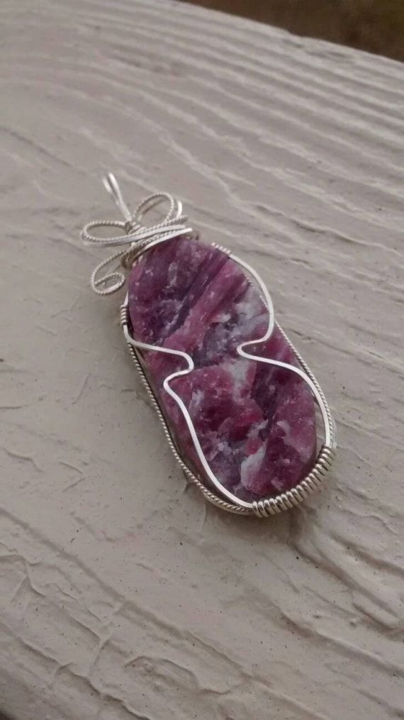 Check out this item in my Etsy shop https://www.etsy.com/listing/497266380/sterling-wrapped-tourmaline-in-quartz