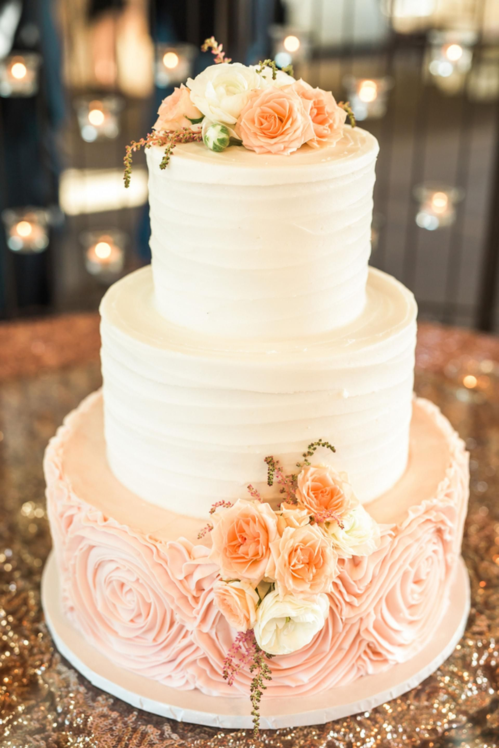 pretty in pink wedding cake  white and peach floral cake