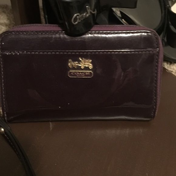 """Authentic Coach Wallet/Wristlet Measures 6""""x4""""X1"""". Has one pocket on outside, one slide pocket inside with 3 cc holders. Patten leather Deep Purple with Sparkles exterior & dark Teal interior of polyester. Gold hardware with a 6"""" attached strap. Purchased a Coach Bag @ The Coach Store in Independence, Missouri & recvd this wallet  with my purchase. Very flexible on price BC of that. So, use the offer button & see what happens ️ Coach Bags Wallets"""