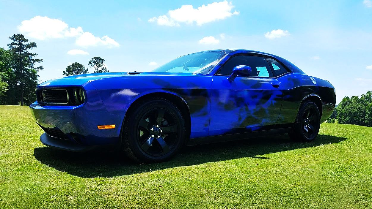 The Sign Essentials Dodge Challenger blue flame vehicle