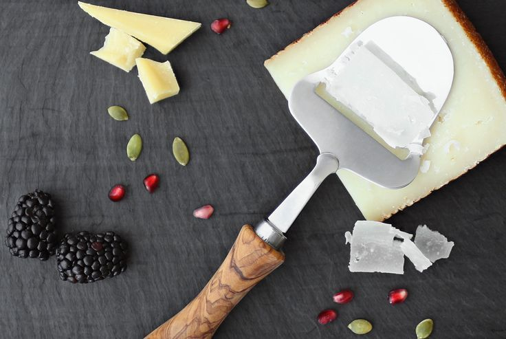 Give a cheese lover or your favorite entertainer this affordable & beautiful cheese plane with a great block of cheese. Yum. | Gorgeous hostess gifts for under $50: Cool Mom Eats holiday gift guide