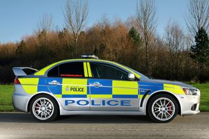 Mitsubishi Lancer Evolution X Police Car Another Powerful Weapon Of The British Police In Its Fight Against Crime Is T Police Cars British Police Cars Police