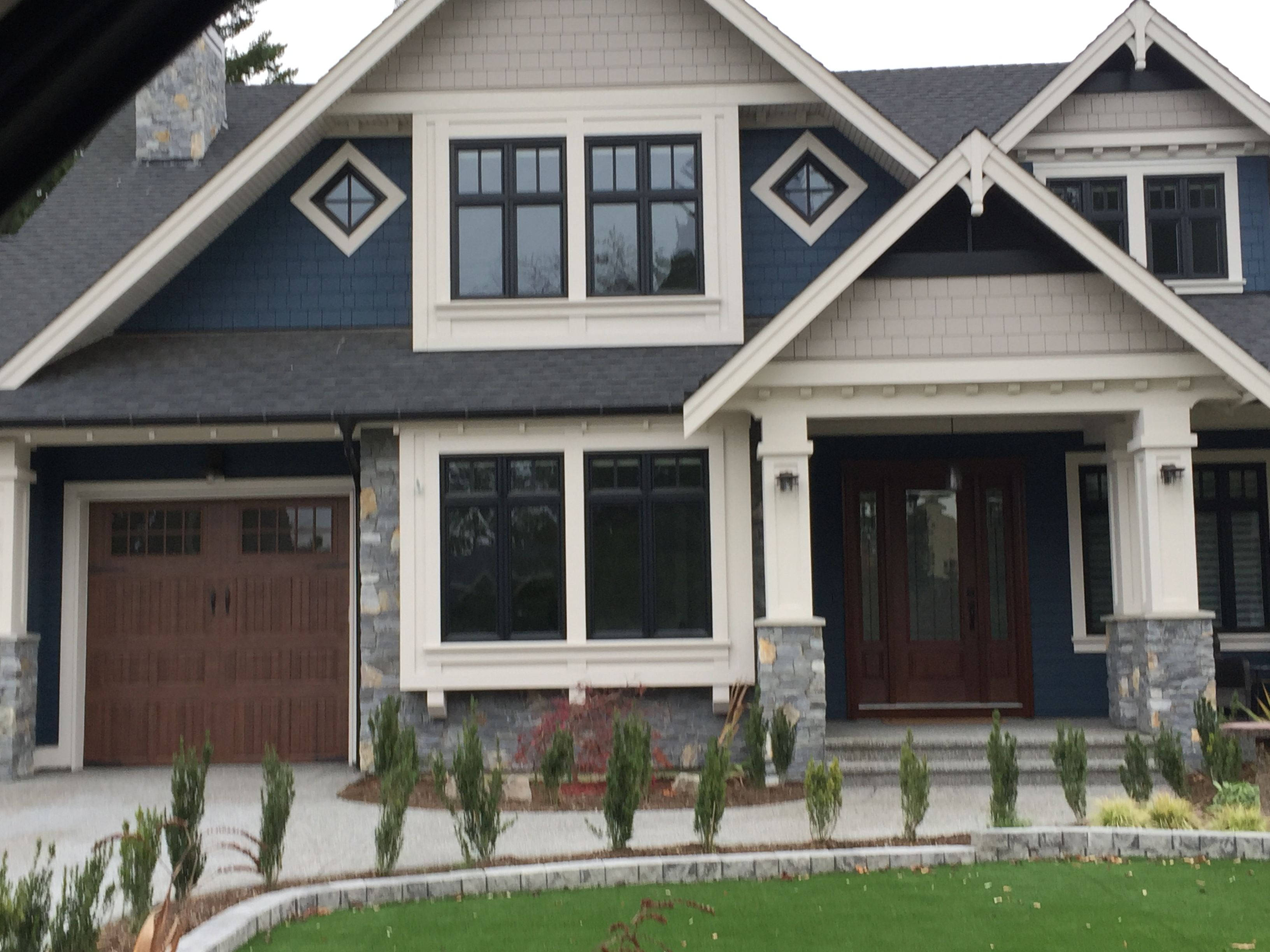 Exterior Palette With Black Windows Blue Siding Cream