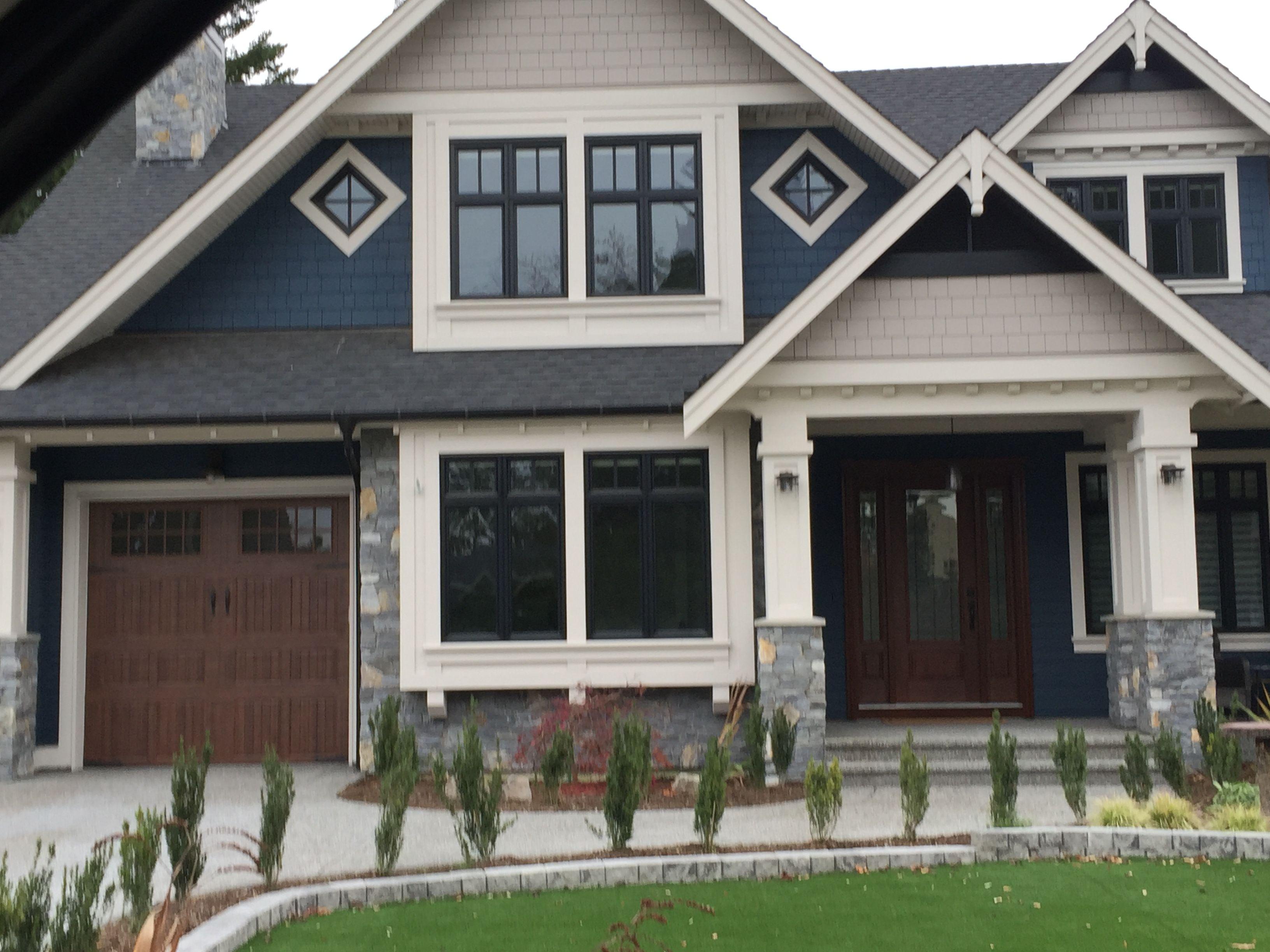 Exterior palette with black windows, blue siding, cream ...