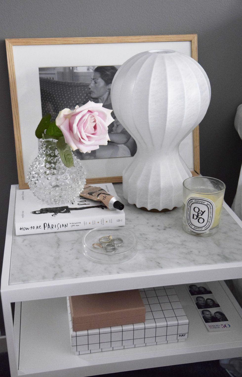 Achille Castiglioniu0027s Gatto Lamp For FLOS Adds An Elegant Touch To A Marble Bedside  Table,