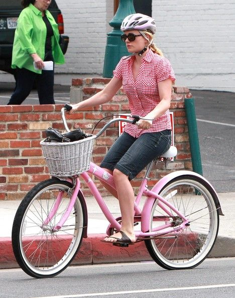 Anna Paquin riding a bike
