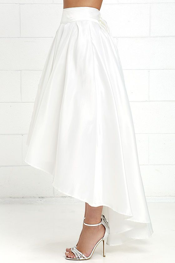 52cf546e99 With the elegant silhouette of the Modern Mystery Ivory Satin High-Low Skirt,  you are destined to make an grand entrance! Jaw-dropping poly satin creates  a ...