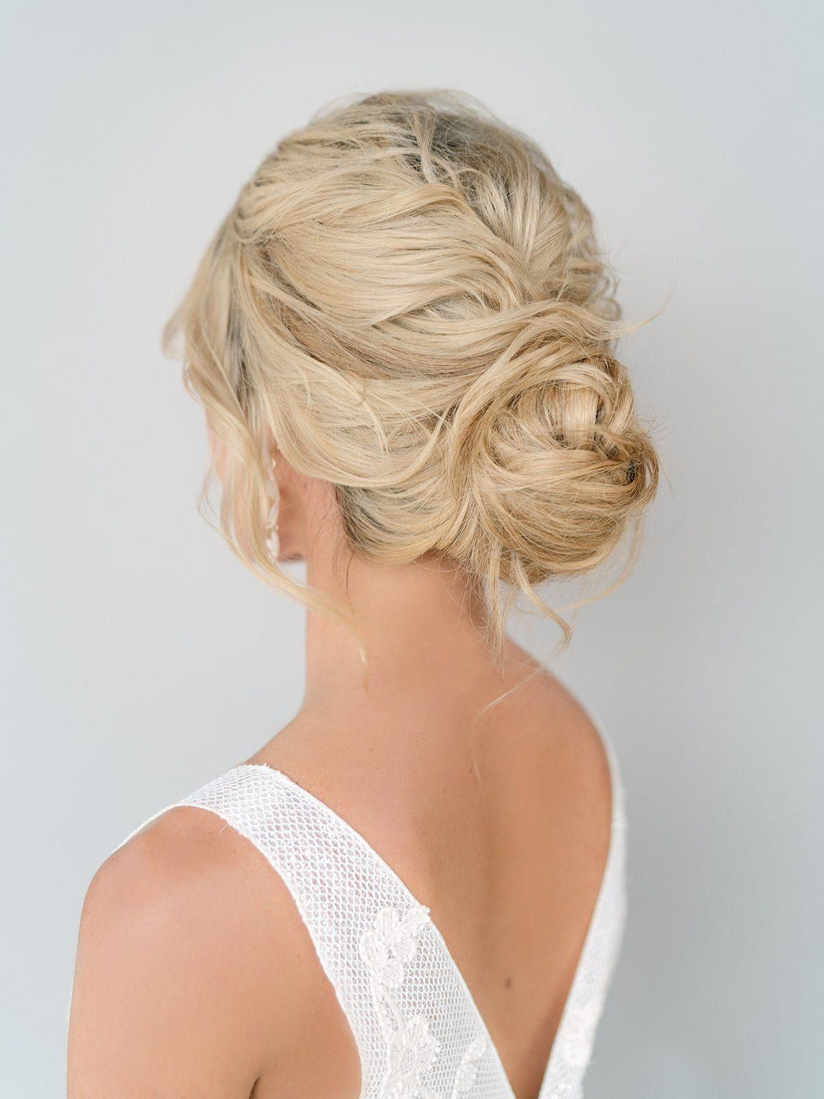 Loose, Braided Bun - Bridal Updo / Wedding Hairstyles - Beach Wedding Fashion // Venue: Balmoral Crystal Clear Lagoon | Photo: Stephania Campos | Videography: Meant To Be Films | Ceremony & Reception Dresses, Veil: Belle Âme Bridal | Makeup & Hair: Adorne Artistry // #weddinghair #bridal #updo #bun #hairstyle #fashion #weddinglook #bridalhair #hairstyles #bride #weddingtheme #blondehair #2020 #trending #hairupdos # loose Braids makeup #loosebraids