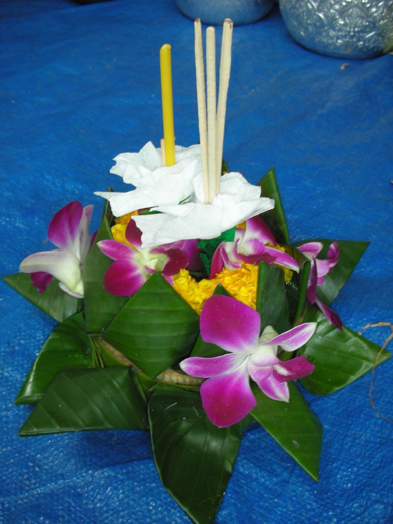 "Loy Kratong 3: You need to arrange the flowers in the ""cup"" of the decoration before then inserting the candle on a stick and incense sticks somewhere near the middle."
