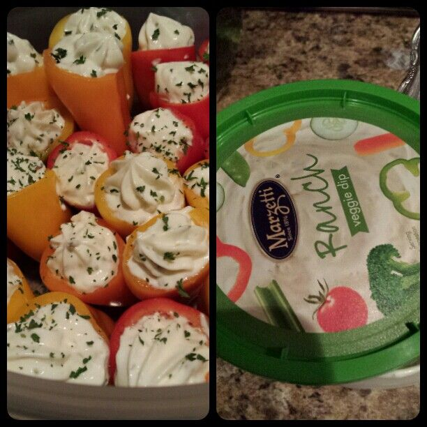 Sweet peppers stuffed with ranch veggie dip & chives on top